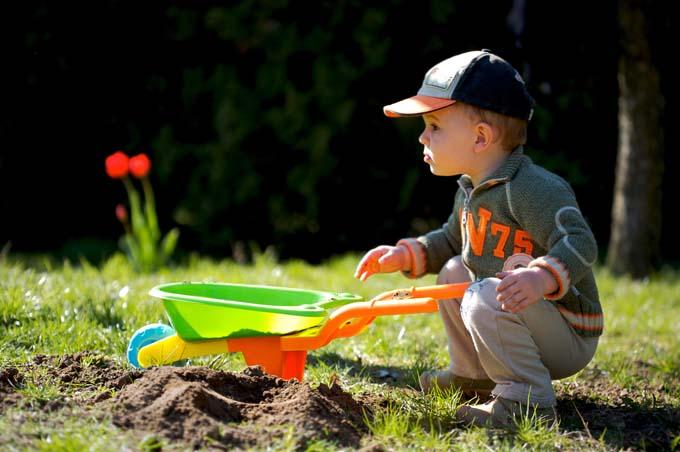 Boy Gardening | GardenersPath.com