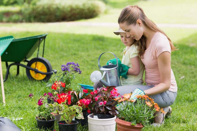 The best gardening gifts for mothers day gardeners path mother and daugher neal in garden next to potted plants and wheel barrow workwithnaturefo