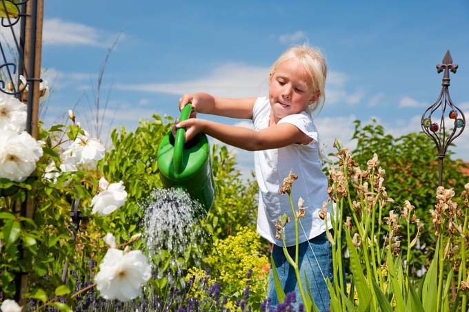 Girl Watering Flowers | GardenersPath.com