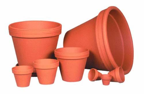 Varios Sizes Of Terracotta Clay Planters On Isolated Background