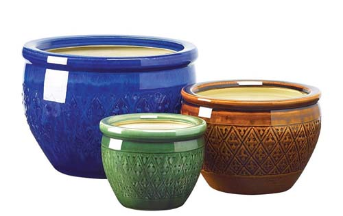 A set of three very colorful ceramic planters - green, brown, and cobalt blue