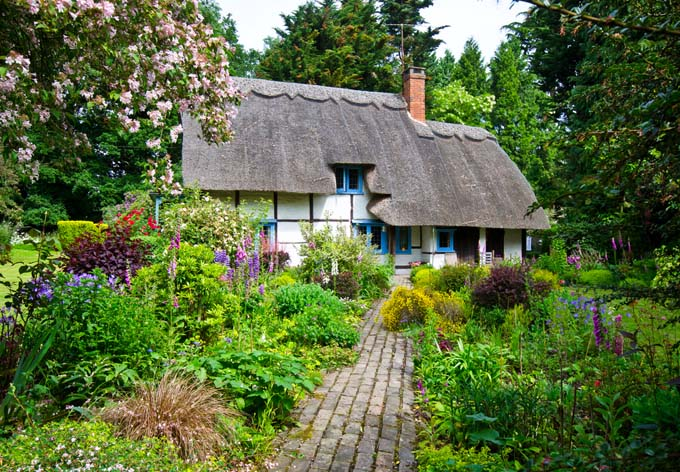 Cottage Garden with Tudor-style House | GardenersPath.com