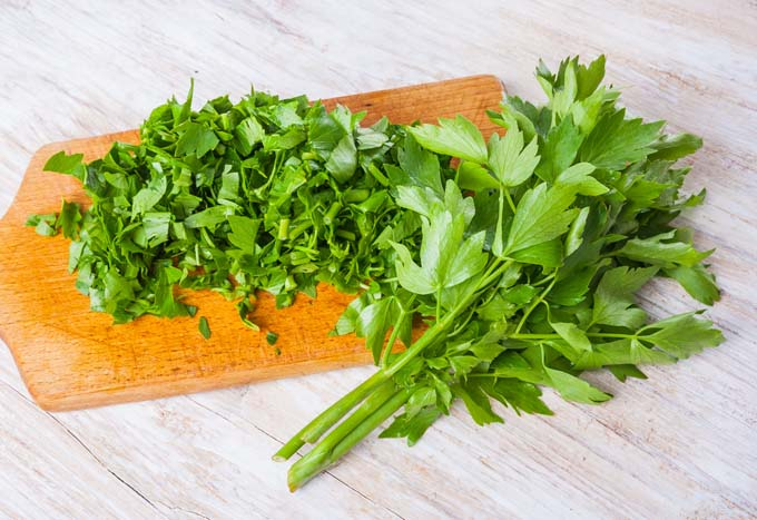lovage leaves and chopped on cutting board