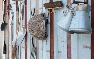 Hanging tools in the shed| GardenersPath.com