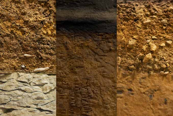 A close up of a cross-section of various different soil types.