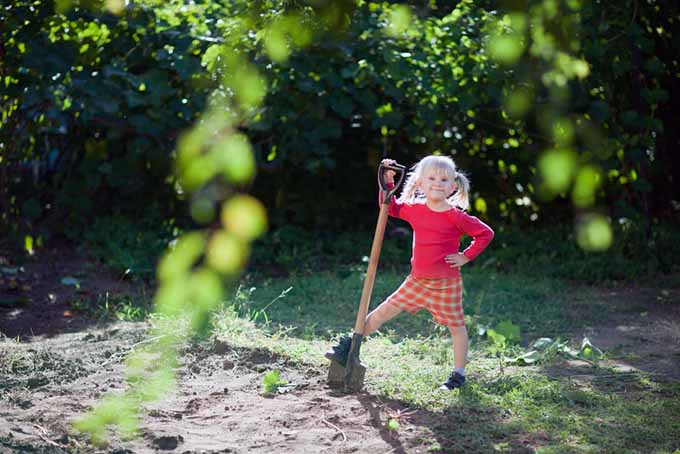 Girl with Pigtails and Shovel | GardenersPath.com