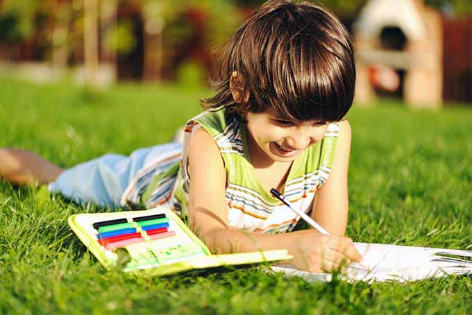 Kid Drawing Outside | GardenersPath.com