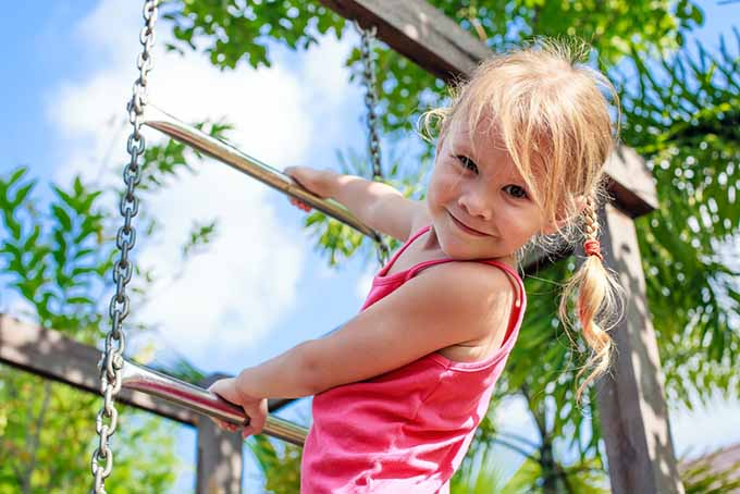 Girl on Playground Ladder | GardenersPath.com