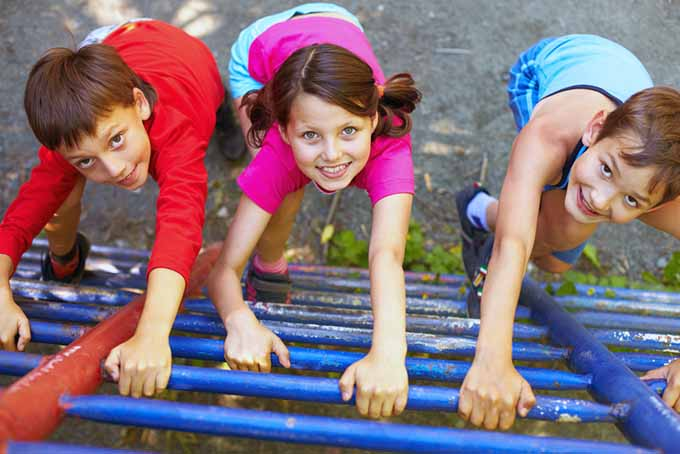 Kids Climbing Up Playground Equipment | GardenersPath.com