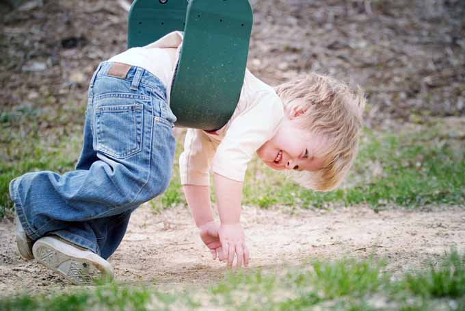 Little Boy Dangling on Swing | GardenersPath.com