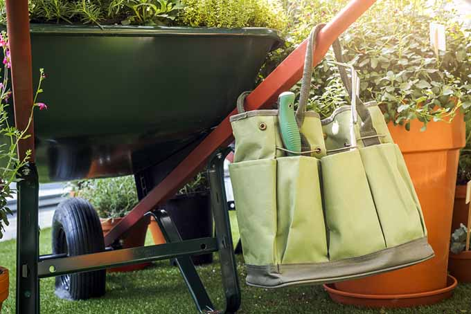 Tote Bag Hanging on Wheelbarrow | GardenersPath.com