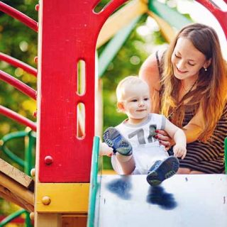Woman and Baby on Slide Cover | GardenersPath.com