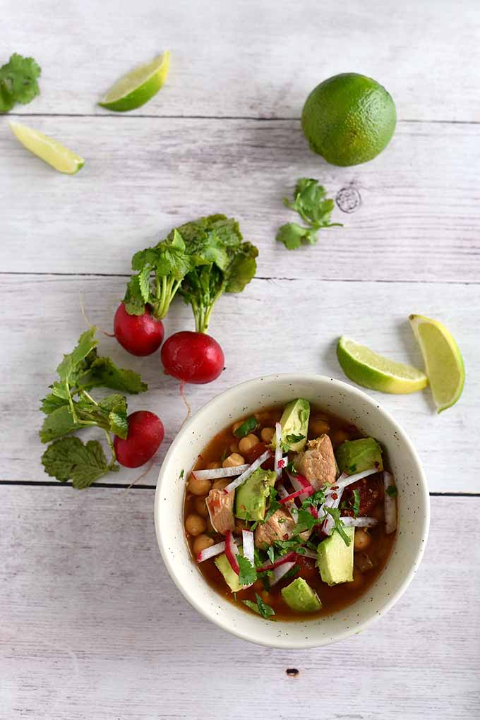 Easy Pork Posole with avocado, radish, and cilantro. | GardenersPath.com