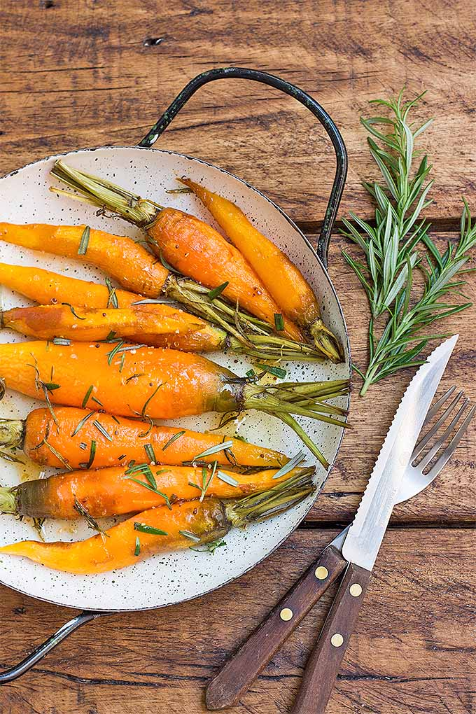 Learn more about how to grow your own rosemary, and get this delicious recipe for Roasted Carrots with Rosemary and Honey: https://gardenerspath.com/plants/herbs/grow-rosemary/