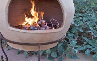 Backyard fire pit with chimney. | GardenersPath.com