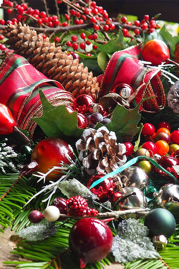 Start gathering those pine cones, evergreen boughs, and holly branches. It's time to make a simple holiday swag to decorate for Christmas. Read our simple tutorial now, or Pin It for later: https://gardenerspath.com/how-to/design/diy-holiday-swag/ #holidaydecorations #Christmas #pine #holly #DIY #tutorial