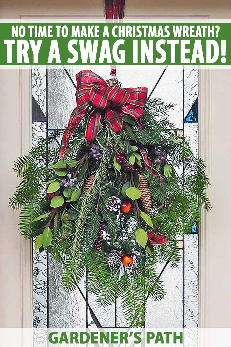 A homemade wreath-like Christmas swag decoration hanging on a front door.