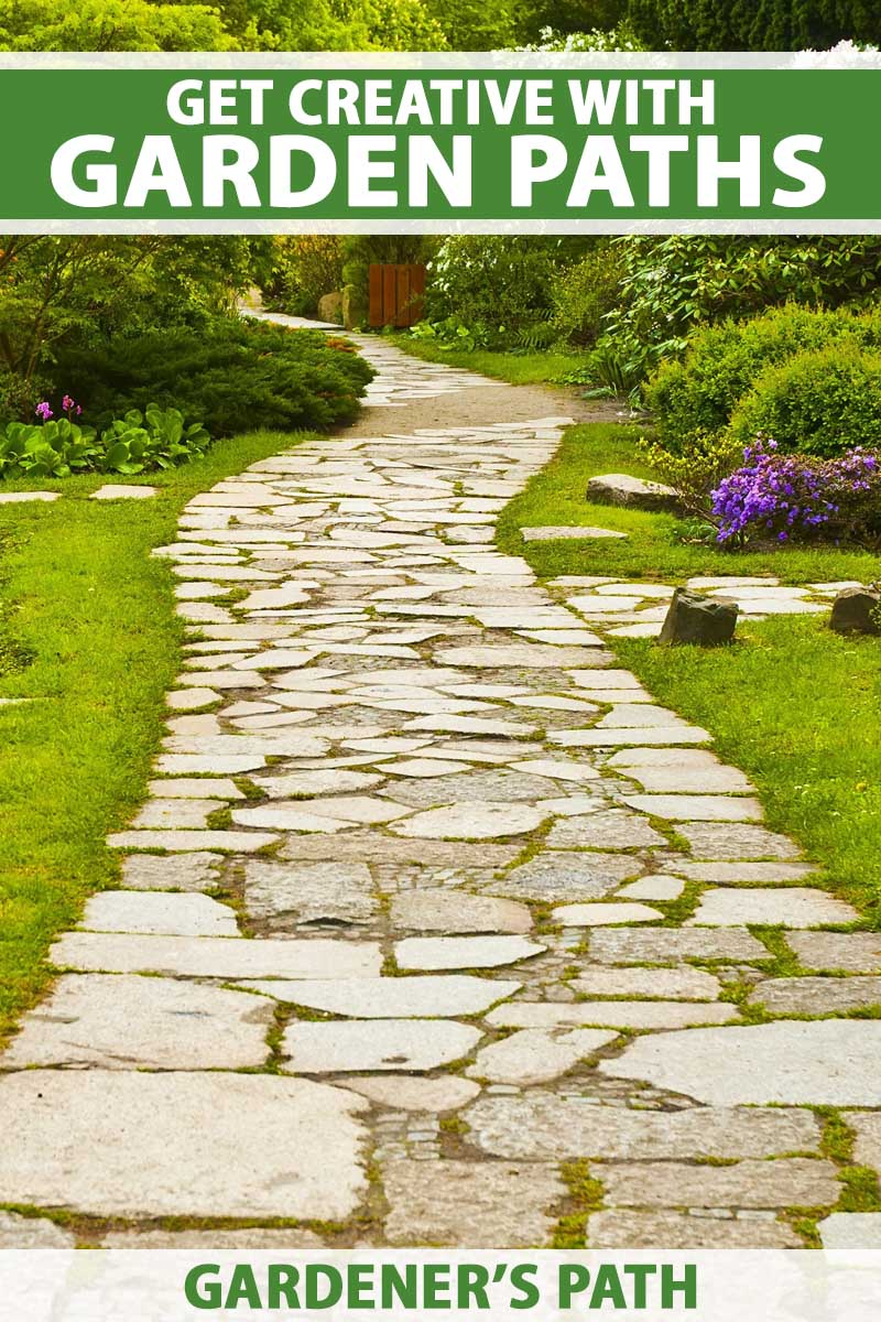 A flagstone path in a landscaped garden.