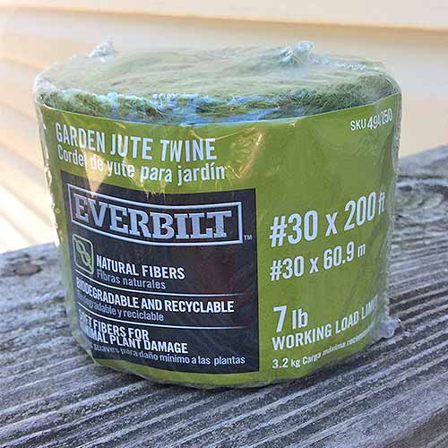 A spool of Everbilt garden jute twine, wrapped in plastic.