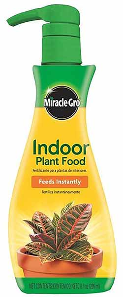 A bottle of Miracle-Gro Indoor Plant Food, isolated on a white background.