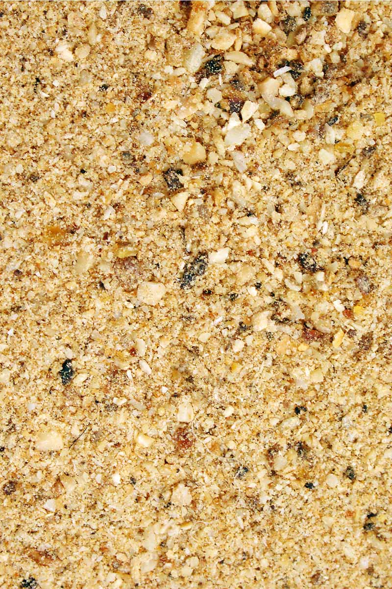 Vertical closeup image of bone meal fertilizer.