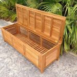 Oblique view of a wooden deck box in tropical patio setting.