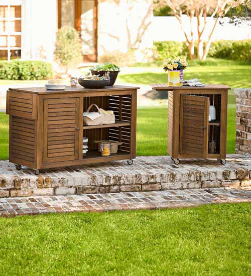 Large and Small Lancaster Eucalyptus Wood Rolling Carts in backyard setting.