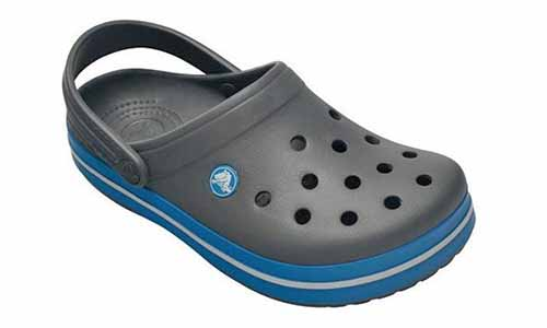 Crocs brand charcoal gray and blue clog, isolated on a white background.