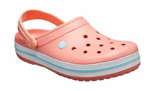 Crocs brand pink, white, and light blue clog with ankle strap, isolated on a white background.