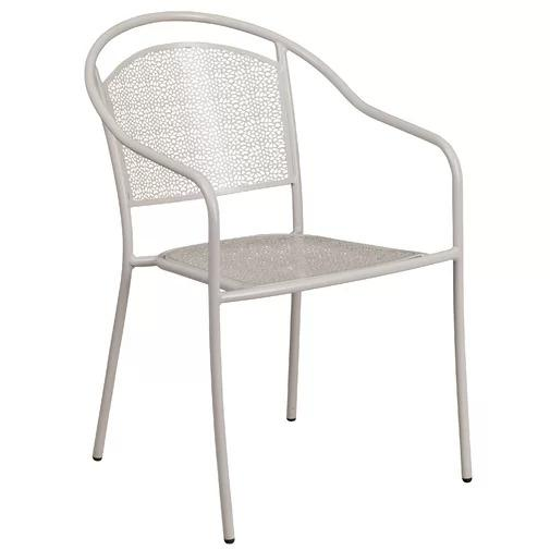 Minna Stacking Patio Dining Chair in white on a white, isolated background.