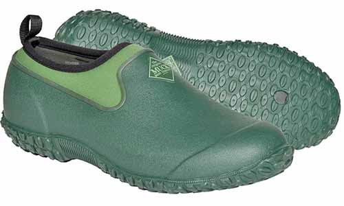 Muck Boots brand Muckster II women's green garden shoes, isolated on a white background.