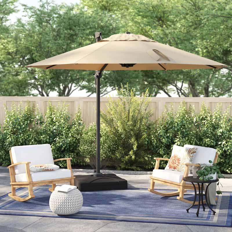 Sol 72 Bellana Cantilever Umbrella in tan in a landscaped ornamental garden area.