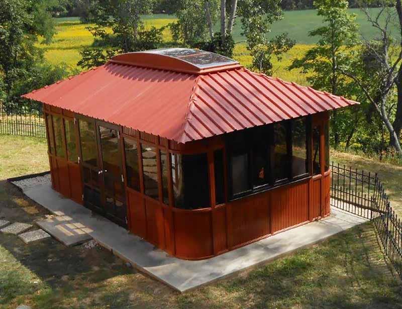 Aspen 19.5 Ft. W x 11.5 Ft. D Solid Wood Patio Gazebo. Raised, oblique view in a backyard setting.