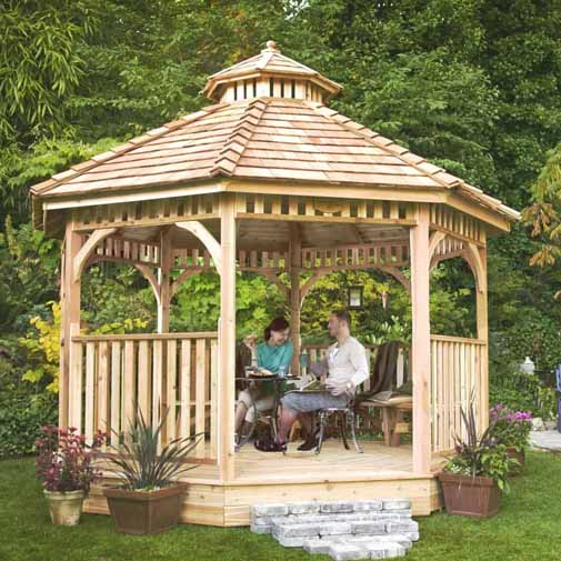Bayside 12 Ft. W x 12 Ft. D Solid Wood Patio Gazebo in backyard setting with a male and female couple enjoying the evening.