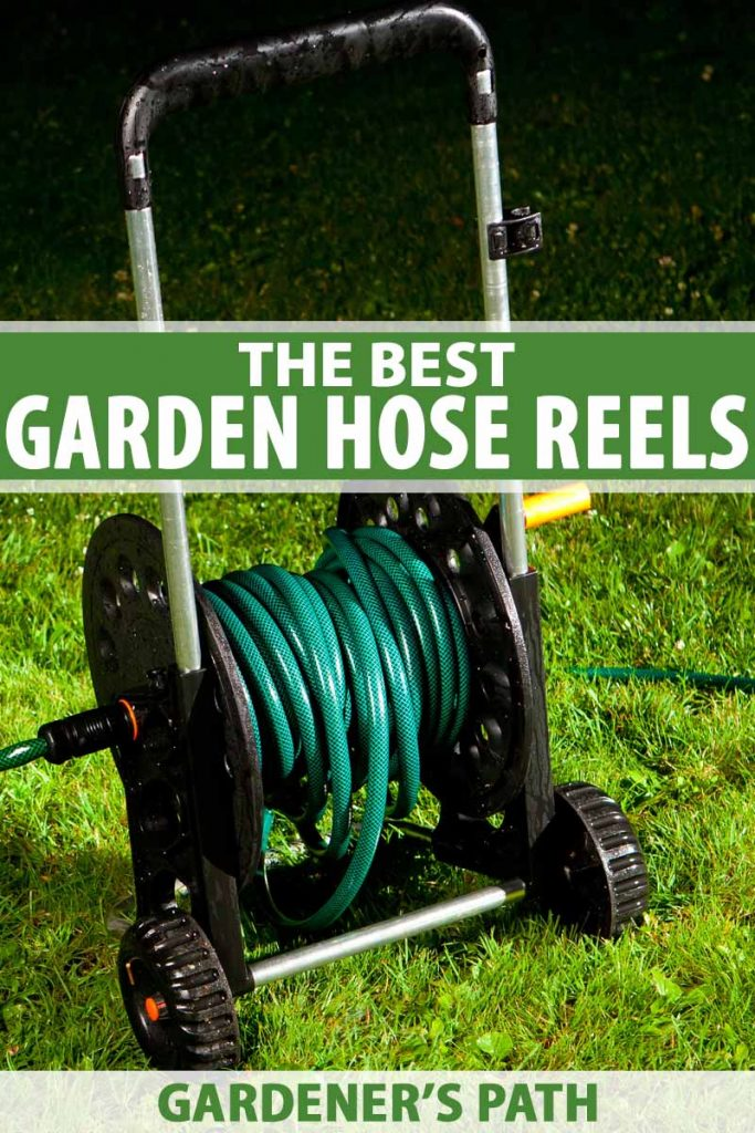 A wheeled garden hose reel on a green lawn at night.