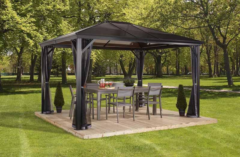 Verona 10 ft. x 14 ft. Aluminum Gazebo in Dark Gray in a park-like tee covered backyard environment.