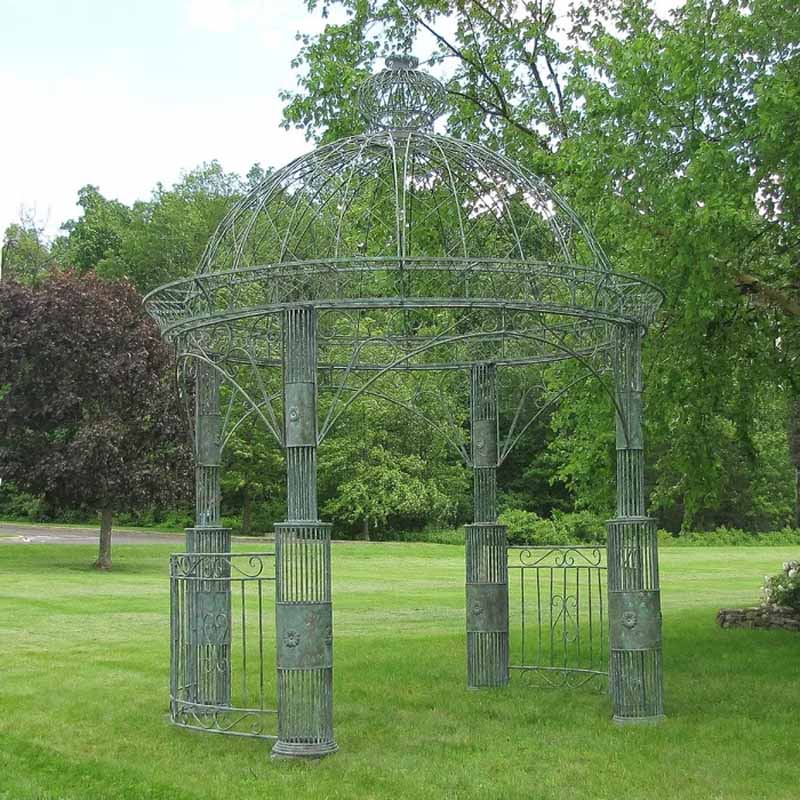 Zina 11 Ft. W x 11 Ft. D Steel Patio Gazebo in a green grassy lawn.