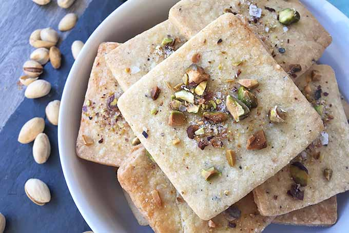 Top down view of homemade sweet and crunchy cardamom and saffron crackers.