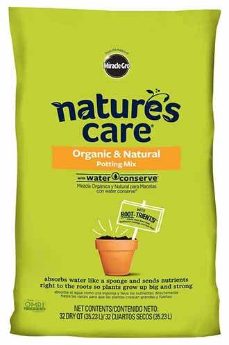 A close up of the packaging of Nature's Care organic potting mix, with green packaging and black text.