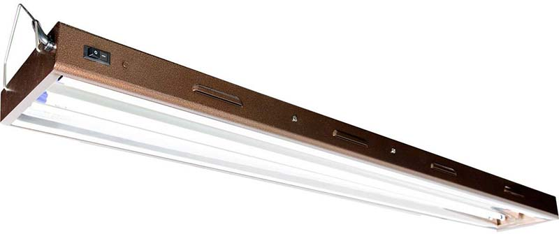 A close up of a long metal indoor grow light made by Hydrofarm containing two fluorescent tubes, on a white background.