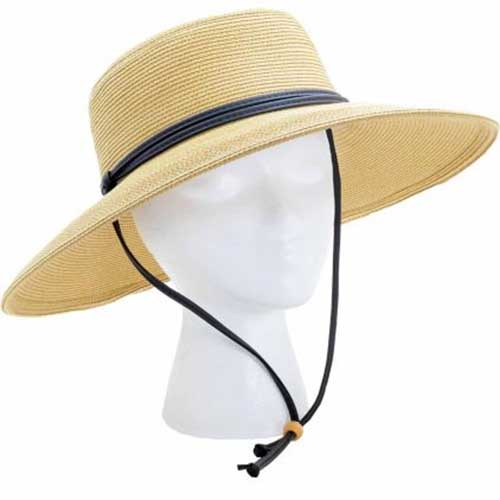 A close up of a beige sunhat on a white background.