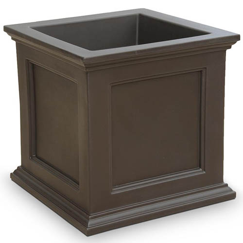 A close up of a brown square planter on a white background.
