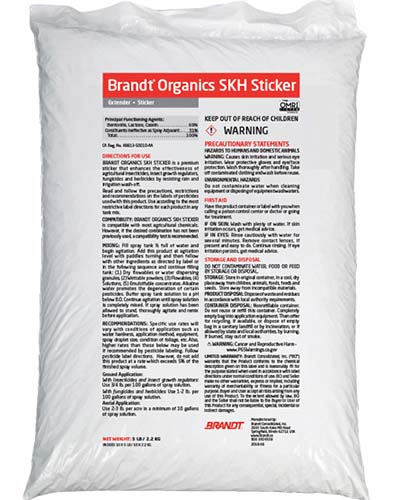 A close up of the packaging of a white plastic bag of Brand Organics SKH Sticker, for helping fungicide to stick to plants.