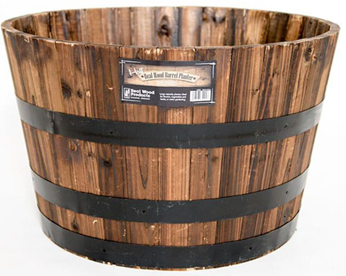 A close up of a cedar barrel planter for growing outdoor crops.