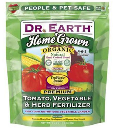 A close up of the green and red packaging of Dr Earth Tomato, Vegetable, and Herb Fertilizer on a white background.