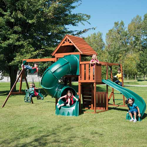 The Grandview Twist Complete Swing Set providing lots of fun for children in a sunny backyard.