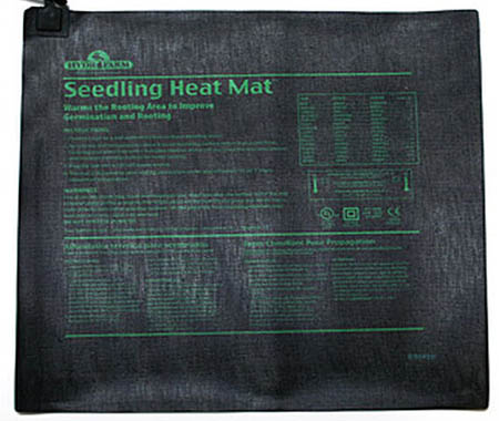 A close up of a seedling heat mat on a white background.