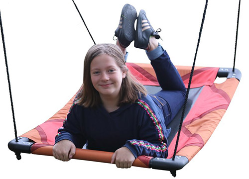 A close up of a child on a red and black swing seat, pictured on a white background.