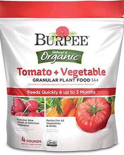 A close up of the packaging of tomato food from Burpee, on a white background.