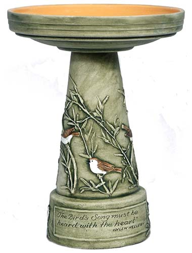 A close up of a hand painted garden pedestal on a white background.